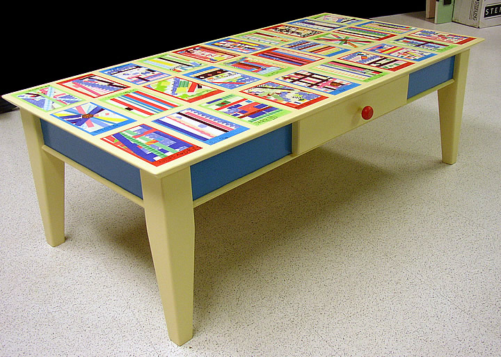 coffee table with children's art decorating the top