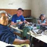 Enedina, Juan and Gabbie pose in the ceramics classroom