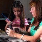 Martha and Gabbie work on their ceramic artworks