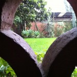 View of the courtyard through the tiles at the Instituto Cultural Oaxaca in the rain