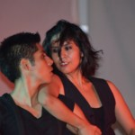 Dance performers gaze at one another