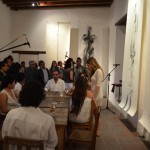 Art opening at the Graphic Arts Institute of Oaxaca showing art and musicians